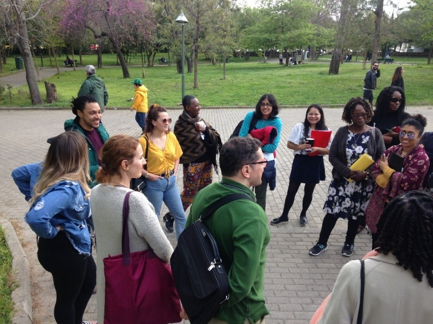 A photo of Sankofa Intergenerational Learning Hub participants standing as a group in a park