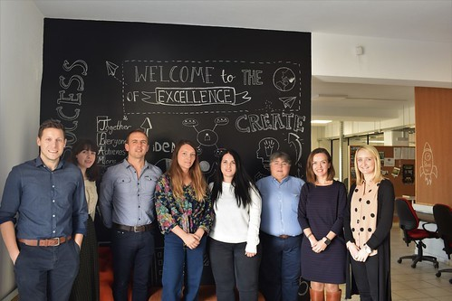 "A group of young adults - including the blog's author Dominic McGeown - stand in front of a chalkboard on which ""WELCOME TO THE WORLD OF EXCELLENCE"" is written along with other words like ""create"", ""idea"", and ""success""."
