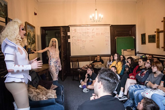 Drag queens delivering a presentation to a group