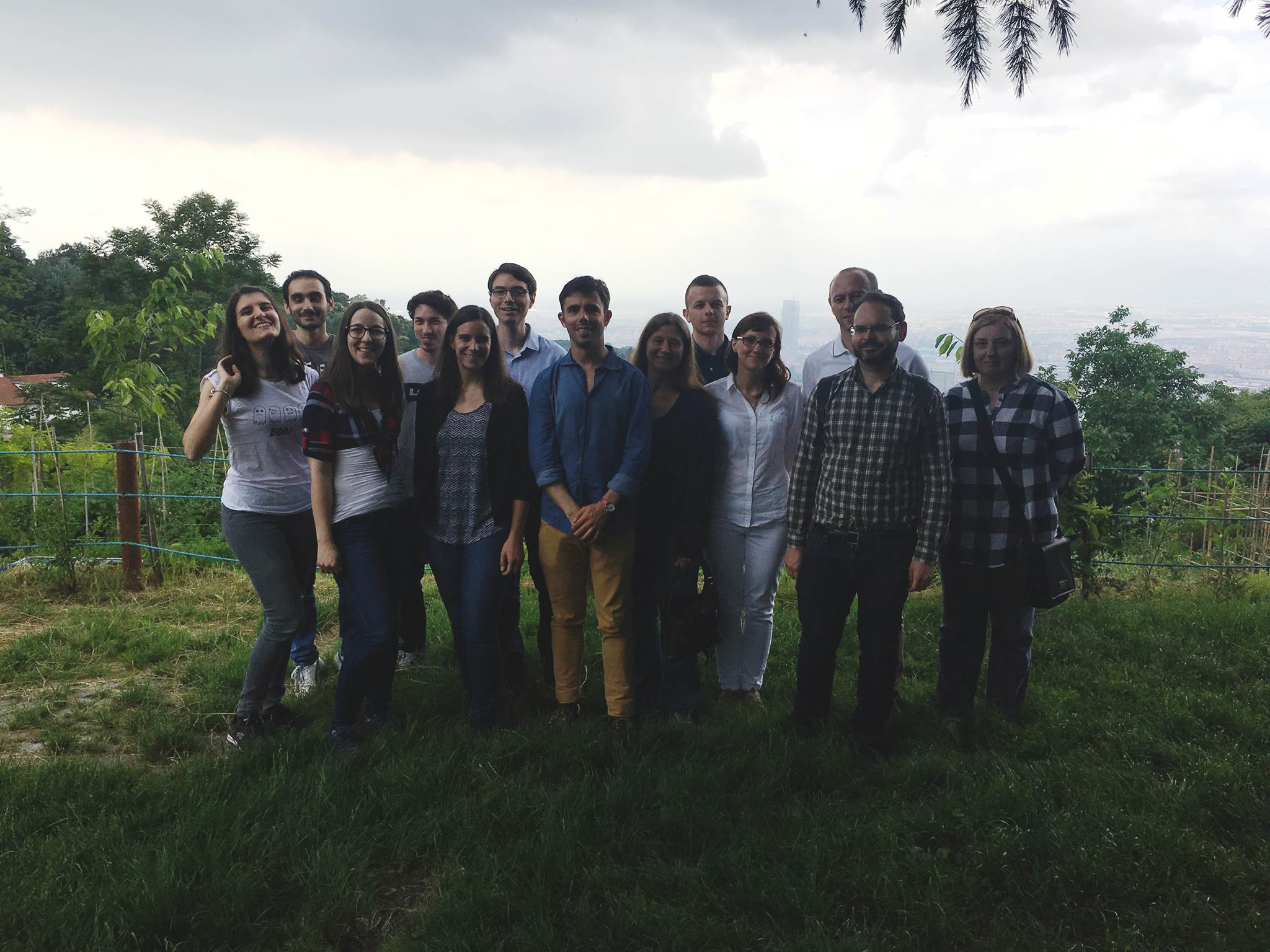 A group photo of the Environmental Learning Illustrated project team members standing in a field.