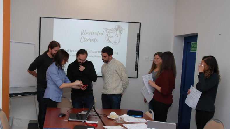 A group photo of the Environmental Learning Illustrated project team members planning in a conference room.