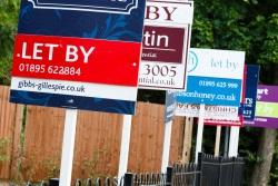 Estate agents' signs outside houses