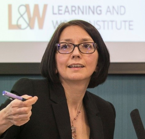 A photo of Fiona Aldridge with the Learning and Work Institute logo behind her.