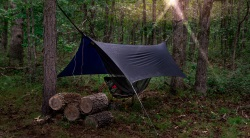 Hammock with a waterproof cover in woodland