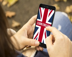 Someone on smartphone with image on screen of Union Jack and 'Learn English' text