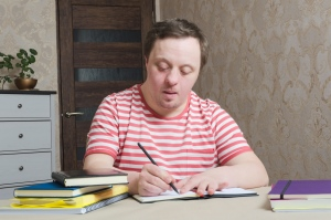Man with learning disabilities studying
