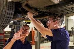 Mechanic training a young man