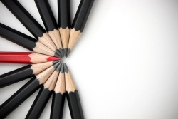 Group of pencils with one red pencil