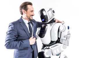 Man embracing a robot