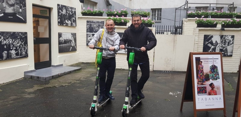 Justin and Jamie on scooters in Warsaw