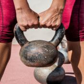 Woman training in gym with kettlebell