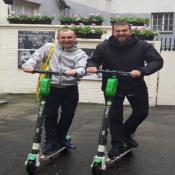 Jamie and Justin on scooters in Warsaw