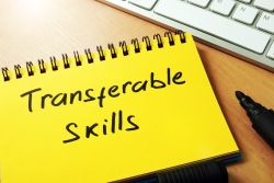 Transferable skills written on a yellow notebook