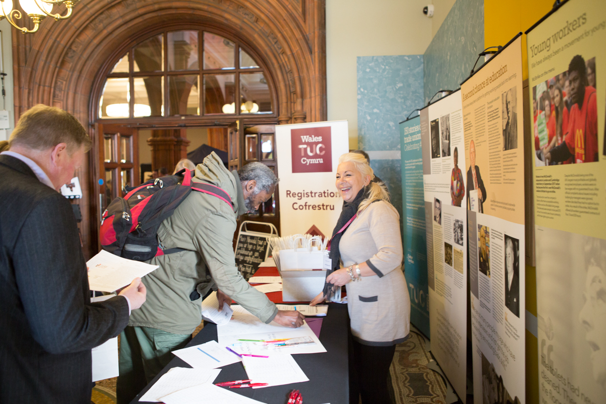 A photo of people registering for a Wales TUC learning event